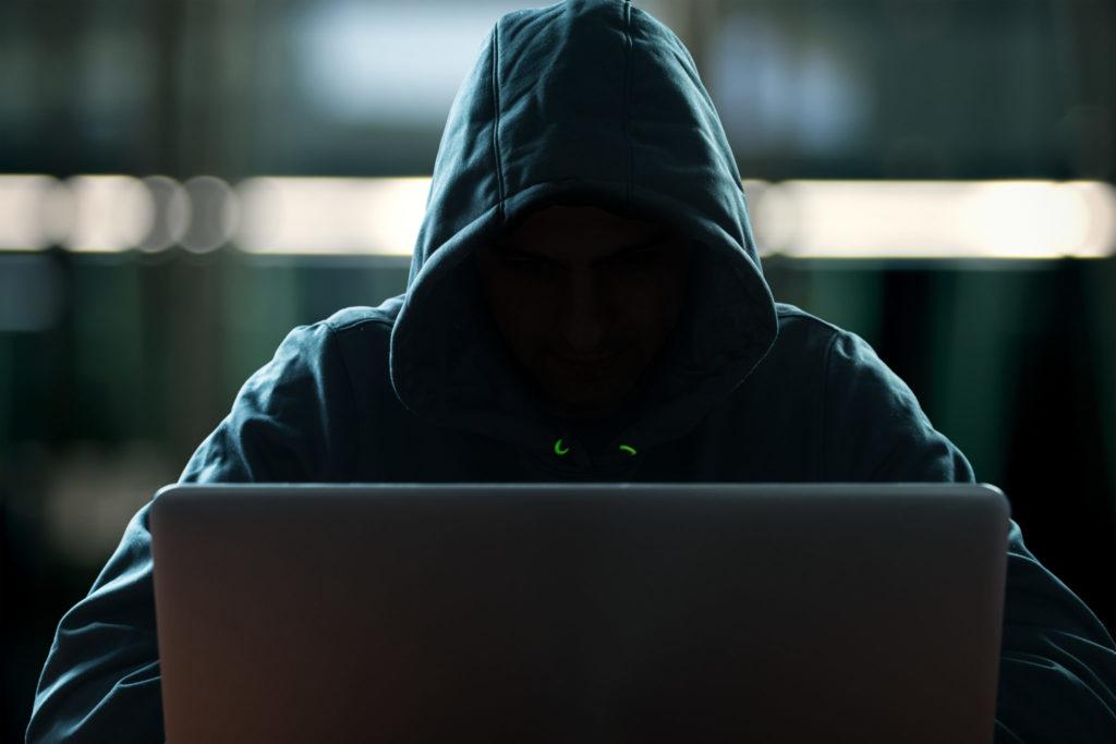 A hacker looking at his computer