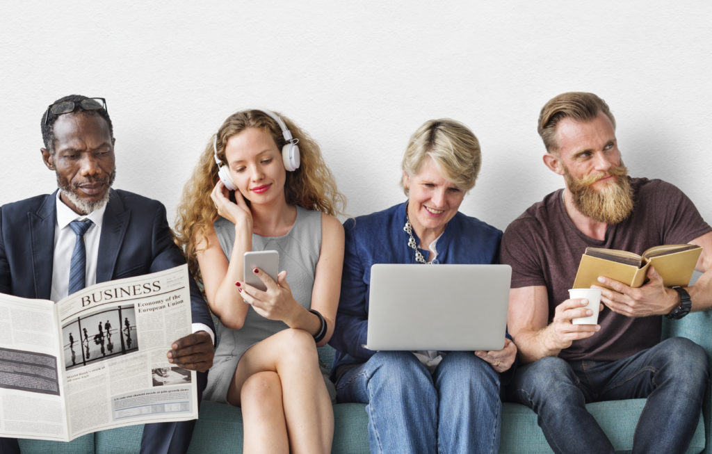 People reading a variety of print and electronic devices