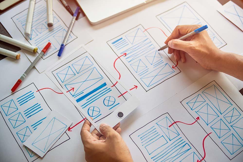 Designer drawing website plans