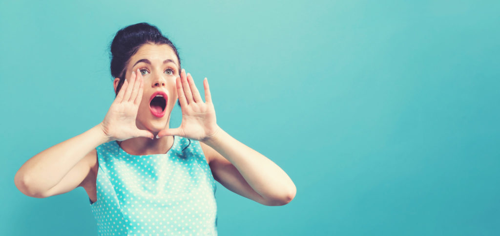 Woman shouting; engaging website audience with quality content